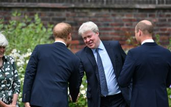 Earl Spencer is greeted by his nephews the Duke of Cambridge (right) and Duke of Sussex (left) as he arrives for unveiling of a statue they commissioned of their mother Diana, Princess of Wales, in the Sunken Garden at Kensington Palace, London, on what would have been her 60th birthday. Picture date: Thursday July 1, 2021.