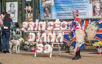 Royal well wishers place tributes with flowers pictures and flags outside Kensington to the late Princess Diana who would have celebrated her 60th birthday today. Prince William, duke of Cambridge and Prince, Duke of Sussex will later unveil a statue to honour their late mother who was tragically killed on 31 August 1997.    Pictured: GV,General View  Ref: SPL5235756 010721 NON-EXCLUSIVE  Picture by: AGZ / SplashNews.com    Splash News and Pictures  USA: +1 310-525-5808 London: +44 (0)20 8126 1009 Berlin: +49 175 3764 166  photodesk@splashnews.com    World Rights,