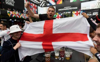 epa09311100 England supporters cheer ahead of a public viewing of the UEFA EURO 2020 round of 16 soccer match between England and Germany at Boxpark in Croydon, London, Britain, 29 June 2021.  EPA/VICKIE FLORES