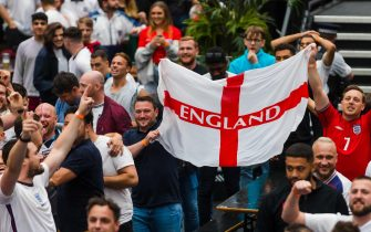 epa09311802 England supporters react when England scores a goal as they watch a public viewing of the UEFA EURO 2020 soccer match between England and Germany, in Boxpark, Croydon, London, Britain, 29 June 2021.  EPA/VICKIE FLORES