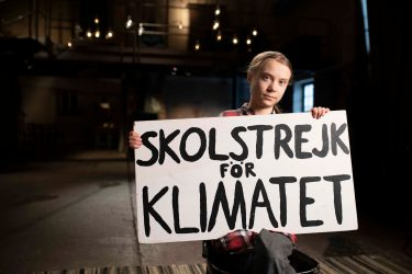 Picture Shows: Greta Thunberg with Sign close up in Stockholm