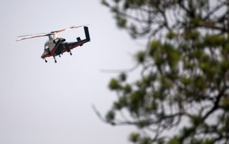 A spotter helicopter flies above a wildfire burning near Lytton, British Columbia, Canada, on Friday, July 2, 2021. Canadian Prime Minister Justin Trudeau called an emergency meeting of a crisis committee to address the wildfires that are raging through the western part of the country as a heat wave shatters records. Photographer: James MacDonald/Bloomberg