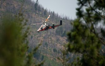 A spotter helicopter searches for wildfires burning near Lytton, British Columbia, Canada, on Friday, July 2, 2021. Canadian Prime Minister Justin Trudeau called an emergency meeting of a crisis committee to address the wildfires that are raging through the western part of the country as a heat wave shatters records. Photographer: James MacDonald/Bloomberg