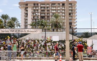 SURFSIDE, FLORIDA - JULY 02: A general view of a memorial that has pictures of some of the missing from the partially collapsed 12-story Champlain Towers South condo building on July 02, 2021 in Surfside, Florida. The pictures were placed on the fence as loved ones try to find them. Over one hundred people are being reported missing as the search-and-rescue effort continues.   (Photo by Michael Reaves/Getty Images)