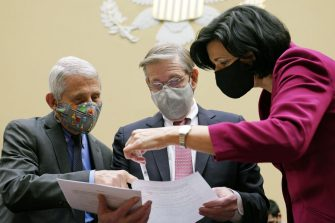 Anthony Fauci, director of the National Institute of Allergy and Infectious Diseases, from left, David Kessler, chief science officer of Covid response at the U.S. Department of Health and Human Services (HHS), and Rochelle Walensky, director of the U.S. Centers for Disease Control and Prevention (CDC), look at a document before the start of a Select Subcommittee On Coronavirus Crisis hearing in Washington, D.C., U.S., on Thursday, April 15, 2021. Top U.S. health officials, set to testify Thursday at a House hearing, are likely to face questions about the governments decision to pause use ofJohnson & Johnsons Covid-19 vaccine after a small number of recipients developed severe blood clots. Photographer: Susan Walsh/AP Photo/Bloomberg via Getty Images