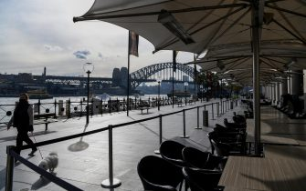 epa09330732 Empty tables and chairs are seen at a closed restaurant along a quiet Circular Quay in Sydney, Australia, 08 July 2021. NSW has recorded 38 new locally acquired COVID-19 cases overnight, the highest daily number of new cases in 14 months.  EPA/BIANCA DE MARCHI AUSTRALIA AND NEW ZEALAND OUT