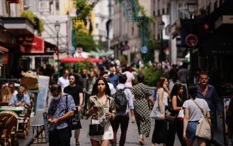 epa09279480 People not wearing protective face masks walk along Montorgueil street in Paris, France, 17 June 2021. France eases some of its coronavirus disease (COVID-19) restrictions starting on 17 June, allowing not to wear a face mask in the streets.  EPA/YOAN VALAT