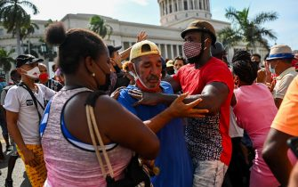 """A man is arrested during a demonstration against the government of Cuban President Miguel Diaz-Canel in Havana, on July 11, 2021. - Thousands of Cubans took part in rare protests Sunday against the communist government, marching through a town chanting """"Down with the dictatorship"""" and """"We want liberty."""" (Photo by YAMIL LAGE / AFP) (Photo by YAMIL LAGE/AFP via Getty Images)"""
