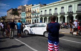 """Cubans march in front of Havana's Capitol during a demonstration against the government of Cuban President Miguel Diaz-Canel in Havana, on July 11, 2021. - Thousands of Cubans took part in rare protests Sunday against the communist government, marching through a town chanting """"Down with the dictatorship"""" and """"We want liberty."""" (Photo by YAMIL LAGE / AFP) (Photo by YAMIL LAGE/AFP via Getty Images)"""