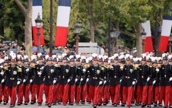 Pupils of the Special Military School of Saint-Cyr (Ecole speciale militaire de Saint-Cyr)  march during the annual Bastille Day military parade on the Champs-Elysees avenue in Paris on July 14, 2021. (Photo by Ludovic MARIN / POOL / AFP) (Photo by LUDOVIC MARIN/POOL/AFP via Getty Images)