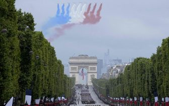 Alphajet aircraft of the 'Patrouille de France' fly over L'Arc de Triomphe during the annual Bastille Day military parade on the Champs-Elysees avenue in Paris on July 14, 2021. (Photo by Michel Euler / POOL / AFP) (Photo by MICHEL EULER/POOL/AFP via Getty Images)