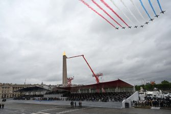 """French elite acrobatic flying team """"Patrouille de France"""" (PAF) flies over Place de la Concorde during the annual Bastille Day military parade on the Champs-Elysees avenue in Paris on July 14, 2021. (Photo by Bertrand GUAY / AFP) (Photo by BERTRAND GUAY/AFP via Getty Images)"""