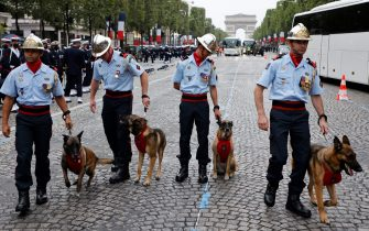 Members of the 14th battalion of French Fire Brigade get ready as preparations are made for the annual Bastille Day military parade on the Champs-Elysees avenue in Paris on July 14, 2021. (Photo by Ludovic MARIN / AFP) (Photo by LUDOVIC MARIN/AFP via Getty Images)