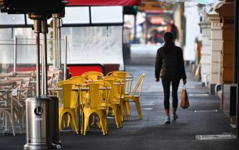 epa09244164 Restaurant furniture is seen left outside of a business along Lygon Street in Melbourne, Victoria, Australia, 03 June 2021. Victoria has recorded three new cases of coronavirus in the past 24 hours, and the lockdown in Melbourne was extended for another seven days.  EPA/JAMES ROSS AUSTRALIA AND NEW ZEALAND OUT