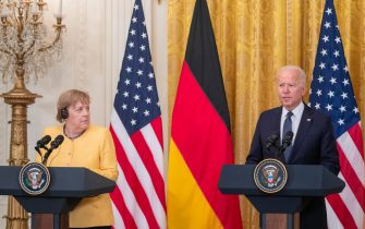epa09347357 US President Joe Biden and German Chancellor Angela Merkel participate in a joint press conference in the East Room of the White House in Washington, DC, USA, 15 July 2021. The two leaders met earlier to discuss the Russian Nord Stream 2 pipeline, climate change, Covid-19 vaccines, and Russian cyber attacks.  EPA/SHAWN THEW