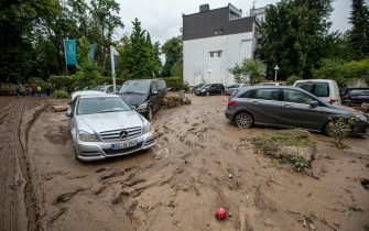 epa09349662 Numerous damaged cars after flooding in Bad Neuenahr, Germany, 16 July 2021. Large parts of Western Germany were hit by heavy, continuous rain in the night to Wednesday, resulting in local flash floods that destroyed buildings and swept away cars.  EPA/CONSTANTIN ZINN