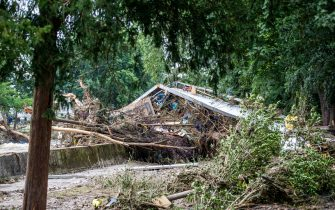epa09349671 A destroyed bridge after flooding in Bad Neuenahr, Germany, 16 July 2021. Large parts of Western Germany were hit by heavy, continuous rain in the night to Wednesday, resulting in local flash floods that destroyed buildings and swept away cars.  EPA/CONSTANTIN ZINN