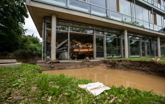 epa09349670 A damaged school after flooding in Bad Neuenahr, Germany, 16 July 2021. Large parts of Western Germany were hit by heavy, continuous rain in the night to Wednesday, resulting in local flash floods that destroyed buildings and swept away cars.  EPA/CONSTANTIN ZINN