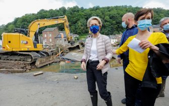 epa09350048 European Commission President Ursula von der Leyen (L) visits flooded places in Pepinster, Belgium, 17 July 2021. Heavy rains have caused widespread damage and flooding in parts of Belgium.  EPA/JULIEN WARNAND