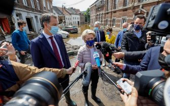 epa09350052 European Commission President Ursula von der Leyen (C) visits flooded places in Pepinster, Belgium, 17 July 2021. Heavy rains have caused widespread damage and flooding in parts of Belgium.  EPA/JULIEN WARNAND