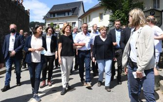 epa09351567 German Chancellor Angela Merkel (C-R) and Rhineland-Palatinate State Premier Malu Dreyer (C-L) inspect the damage after heavy flooding of the river Ahr caused severe destruction in the village of Schuld, Ahrweiler district, Germany, 18 July 2021. Large parts of western Germany were hit by heavy, continuous rain in the night to 15 July, resulting in local flash floods that destroyed buildings and swept away cars, killing dozens of people, while several were still missing.  EPA/CHRISTOF STACHE / POOL