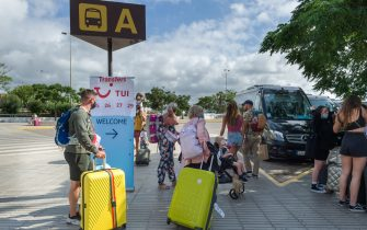 IBIZA, BALEARIC ISLANDS, SPAIN - JUNE 30: Passengers on a flight from Britain wait for a bus after leaving Ibiza Airport on June 30, 2021, in Ibiza, Balearic Islands, Spain. On 24 June, the UK authorities announced that the Balearic Islands had been placed on their COVID-19 green travel risk list, a measure that came into force today and means that returning tourists will not have to undergo quarantine. (Photo By German Lama/Europa Press via Getty Images)