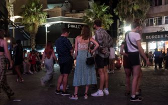 PACEVILLE, MALTA - 10th July 2021: A group of tourists stand in the cenrtre of the town on July 10, 2021 in Paceville, Malta. Malta, Europe's smallest nation, is now on The Uk's green list for travel. (Photo by Joanna Demarco/Getty Images)