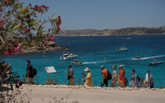 COMINO, MALTA - [11th July 2021]: Tourists walk towards Blue Lagoon on July 11, 2021 in Comino, Malta. Malta, Europe's smallest nation, is now on The Uk's green list for travel. (Photo by Joanna Demarco/Getty Images)