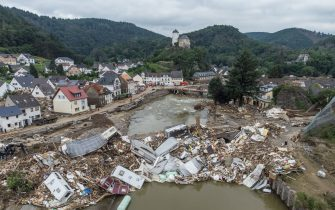 19 July 2021, Rhineland-Palatinate, Altenahr: Caravans, gas tanks, trees and scrap pile up metres high on a bridge over the Ahr (aerial photograph taken with a drone). Numerous houses in the town were completely destroyed or severely damaged, there are numerous fatalities. Photo: Boris Roessler/dpa (Photo by Boris Roessler/picture alliance via Getty Images)