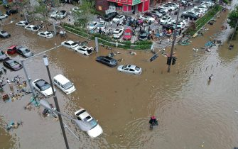 ZHENGZHOU, CHINA - JULY 21: Aerial view of submerged cars and bicycles in a flooded street on July 21, 2021 in Zhengzhou, Henan Province of China. The heavy rain across Henan Province began on July 16, with Zhengzhou being one of the hardest-hit areas. (Photo by Zhang Zong/VCG via Getty Images)
