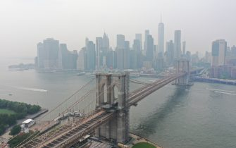 NEW YORK, USA -JULY 20: Wildfires burning out of control across the Western United States causes hazy skies throughout New York City and Washington DC July 20, 2021 in New York, United States. According to the National Weather Service, smoke and haze from raging wildfires out west and in Canada that drifted across the Great Lakes region reached the Eastern Seaboard. The experts said the smoke and fog may continue to affect New York. (Photo by Lokman Vural Elibol/Anadolu Agency via Getty Images)
