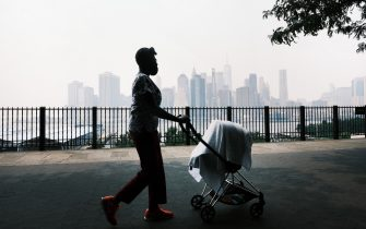 NEW YORK, NEW YORK - JULY 20: The Manhattan skyline sits under a cloud of haze on July 20, 2021 in New York City. According to data from the National Oceanic and Atmospheric Administration, wildfire smoke from the west has arrived in the tri-state area creating decreased visibility and a yellowish haze in many areas. (Photo by Spencer Platt/Getty Images)