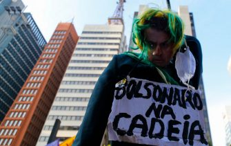 """A puppet of Jair Bolsonaro with a signal that reads """"Prison to Bolsonaro"""" is seen in a demonstration against Bolsonaro's handling of the COVID-19 pandemic in Sao Paulo, Brazil, on July 3, 2021. - Thousands of Brazilians took to the streets Saturday to protest against President Jair Bolsonaro, who faces an investigation over an allegedly corrupt Covid vaccine deal. (Photo by Miguel SCHINCARIOL / AFP) (Photo by MIGUEL SCHINCARIOL/AFP via Getty Images)"""