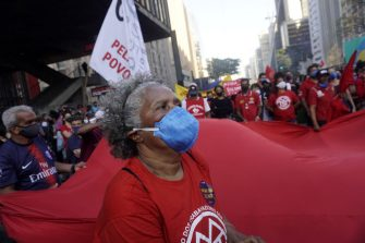 SAO PAULO, BRAZIL - JULY 24: People take part in a demonstration against the Brazilian President Jair Bolsonaro's handling of the coronavirus (COVID-19) pandemic in Sao Paulo, Brazil, on July 24, 2021. - Thousands of Brazilians took to the streets Saturday to protest against President Jair Bolsonaro, who faces an investigation over an allegedly corrupt Covid vaccine deal. (Photo by Cristina Szucinski/Anadolu Agency via Getty Images)