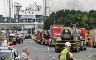 epa09369804 Fire department trucks stand near the site of an explosion at the chemical industry area of 'Chempark' in Leverkusen, Germany, 27 July 2021. The city of Leverkusen has warned citizens on its official website, that an explosion with an unknown cause occurred on the day at the site of the Chempark. Residents are asked to stay indoors and to keep windows and doors closed.  EPA/SASCHA STEINBACH
