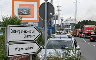epa09369803 Fire department trucks stand near the site of an explosion at the chemical industry area of 'Chempark' in Leverkusen, Germany, 27 July 2021. The city of Leverkusen has warned citizens on its official website, that an explosion with an unknown cause occurred on the day at the site of the Chempark. Residents are asked to stay indoors and to keep windows and doors closed.  EPA/SASCHA STEINBACH