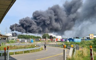 27 July 2021, North Rhine-Westphalia, Leverkusen: A dark cloud of smoke rises above the chemical park. Photo: Mirko Wolf/dpa (Photo by Mirko Wolf/picture alliance via Getty Images)