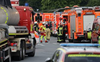 27 July 2021, North Rhine-Westphalia, Leverkusen: Emergency vehicles of the fire brigade stand not far from an access road to the Chempark. After an explosion fire brigade, rescue forces and police are currently in large-scale operation, the police explained. According to the police, several people have been injured. Photo: Oliver Berg/dpa (Photo by Oliver Berg/picture alliance via Getty Images)