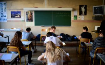 Pupils wait for the start of the first written test in philosophy as part of the Baccalaureat (France's high school diploma) at a school in Paris on June 15, 2017. / AFP PHOTO / Martin BUREAU        (Photo credit should read MARTIN BUREAU/AFP via Getty Images)