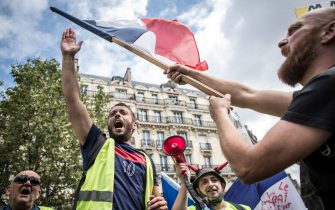 epa09382551 Protesters shout slogans against the government during a demonstration against the COVID-19 health pass which grants vaccinated individuals greater ease of access to venues in France, in Paris, France, 31 July 2021. Anti-vaxxers, joined by the anti-government 'yellow vest' movement, are demonstrating across France for the third consecutive week in objection to the health pass, which is now mandatory for people to  visit leisure and cultural venues.  EPA/CHRISTOPHE PETIT TESSON