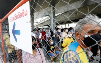epa09372785 Thai crowds are waiting to be vaccinated against COVID-19 at a vaccination center, set up inside the Bang Sue Grand Station in Bangkok, Thailand, 28 July 2021. Many people are trying to get vaccinated against COVID-19 while Thailand has seen a rapid surge in the number cases more than ten thousand people per day continuously in recent days. The Thai government announced it will impose stricter COVID-19 restrictions if the outbreak shows no immediate signs of slowing down.  EPA/NARONG SANGNAK