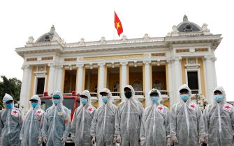 epa09365918 Soldiers from The High Command of Chemicals under Vietnam's Ministry of National Defence get ready before spraying disinfectant throughout the streets of Hanoi as a precaution against the coronavirus, in Hanoi, Vietnam, 26 July 2021. Vietnam is facing the fourth COVID-19 wave, which is by far the worst wave of COVID-19 infections to date.  EPA/LUONG THAI LINH