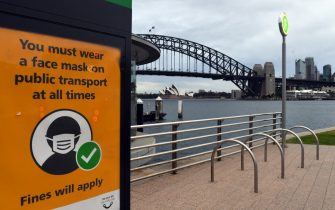 epa09375681 A view of a sign warning about wearing face masks on public transport at a ferry wharf in Sydney, New South Wales (NSW), Australia, 28 July 2021 (issued 29 July 2021). On 29 July, NSW recorded 236 new locally acquired cases of COVID-19 in the last 24 hours to 8pm.  EPA/MICK TSIKAS  AUSTRALIA AND NEW ZEALAND OUT