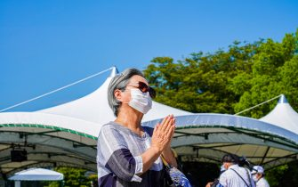 A woman prays at Peace Memorial Park, as Hiroshima marks the 76th anniversary of the atomic bombing. The atomic bombing which killed about 150,000 people and destroyed the entire city for the first bombing with a nuclear weapon in a war. (Photo by Jinhee Lee / SOPA Images/Sipa USA)