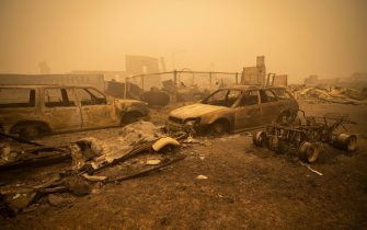 epa09404937 Buildings and vehicles are left destroyed by the Dixie Fire in Greenville, California, USA, 07 August 2021. The Dixie Fire had grown to over 440,000 acres as of 07 August.  EPA/CHRISTIAN MONTERROSA