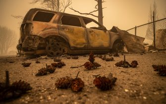 epa09404933 Buildings and vehicles are left destroyed by the Dixie Fire in Greenville, California, USA, 07 August 2021. The Dixie Fire had grown to over 440,000 acres as of 07 August.  EPA/CHRISTIAN MONTERROSA