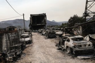 Burned used vehicles following a wildfire at a business in Afidnes on the outskirts of Athens, Greece, on Saturday, Aug. 7, 2021. A wildfire north of Athens forced residents to flee their homes during a heatwave in Greece. Photographer: Konstantinos Tsakalidis/Bloomberg via Getty Images