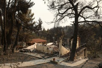 A house destroyed by the wildfire in Drosopigi on the outskirts of Athens, Greece, on Saturday, Aug. 7, 2021. A wildfire north of Athens forced residents to flee their homes during a heatwave in Greece. Photographer: Konstantinos Tsakalidis/Bloomberg via Getty Images