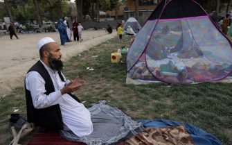 KABUL, AFGHANISTAN - AUGUST 12: Sayed Amanullah from Kunduz prays at a makeshift IDP camp in Share-e-Naw park to various mosques and schools on August 12, 2021 in Kabul, Afghanistan. People displaced by the Taliban advancing are flooding into the Kabul capital to escape the Taliban takeover of their provinces. (Photo by Paula Bronstein/Getty Images)