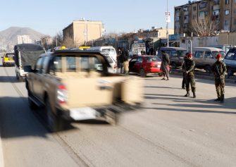 Afghan security officials stand guard on a roadside as security has been intensified after a rocket attack on Italian embasy, in Kabul, Afghanistan, 18 January 2016.  ANSA/HEDAYTULLAH AMID